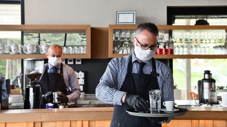 Waiters wearing masks in a restaurant