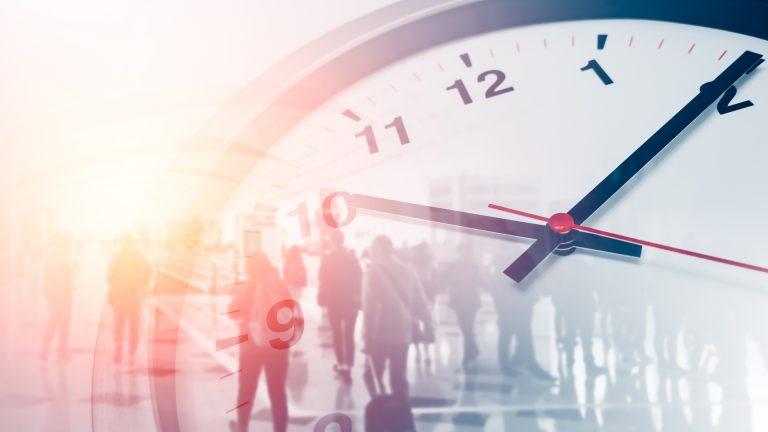 Clock overlaying people working