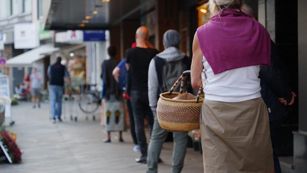 People social distancing in queue
